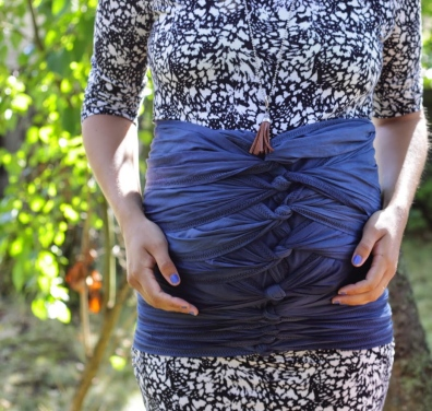 belly binding; doula